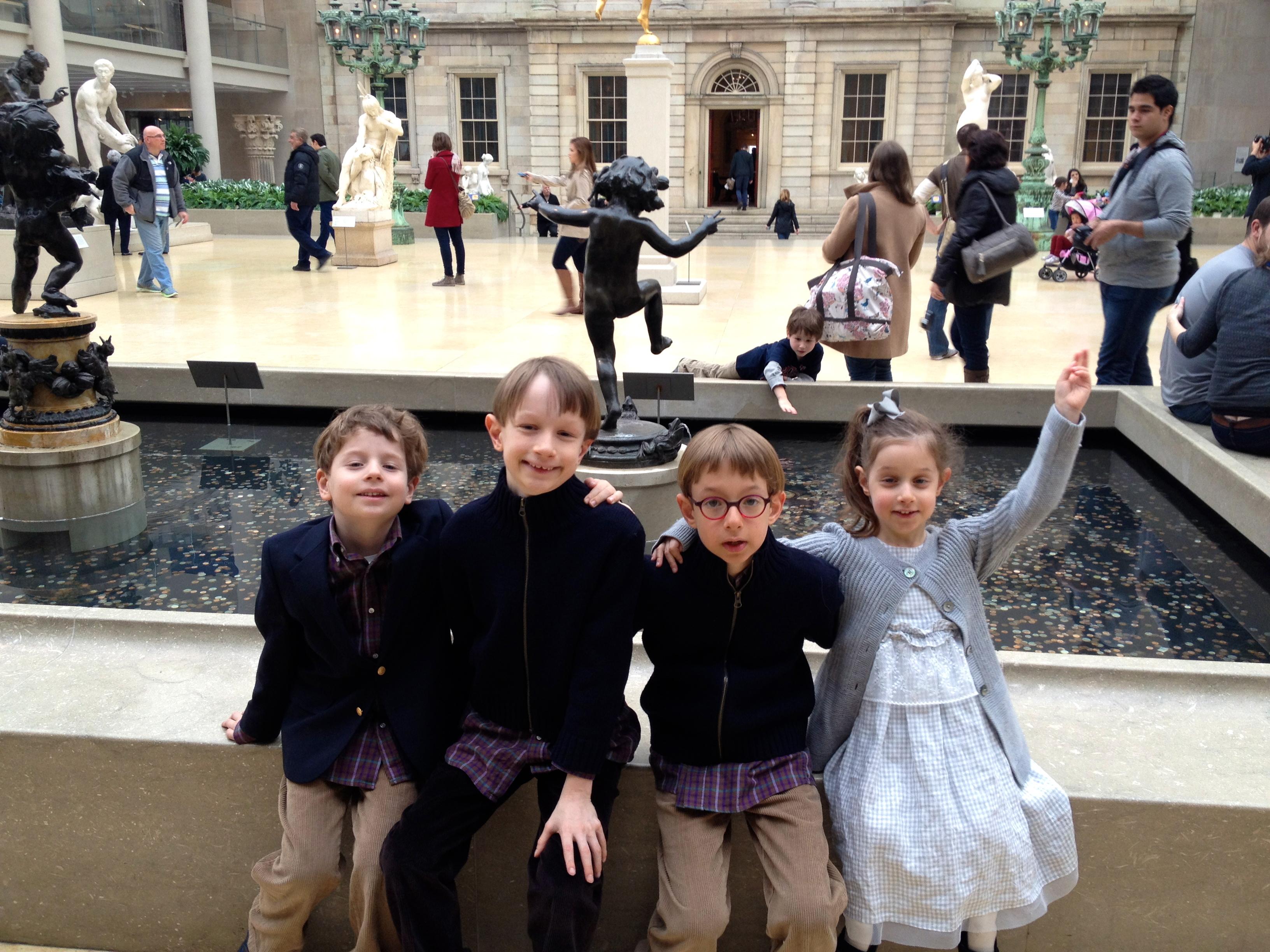 Kids posing at fountain