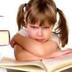 unhappy kid reading