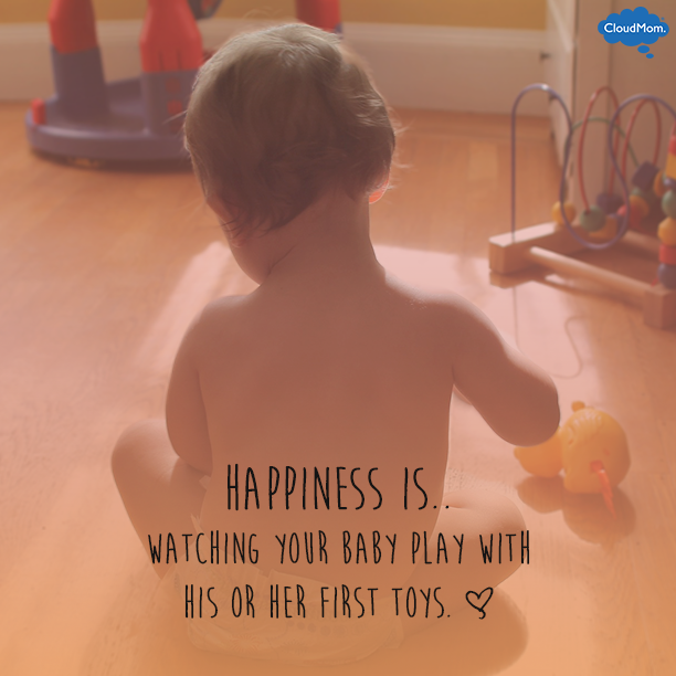 Happiness is.. watching your baby play with his or her first toys. <3