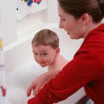 mom giving son a bath