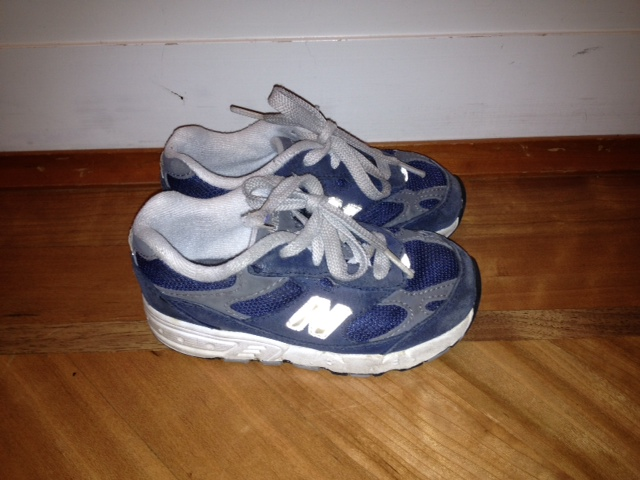 My kids' first pair of baby shoes -- navy blue sneakers.