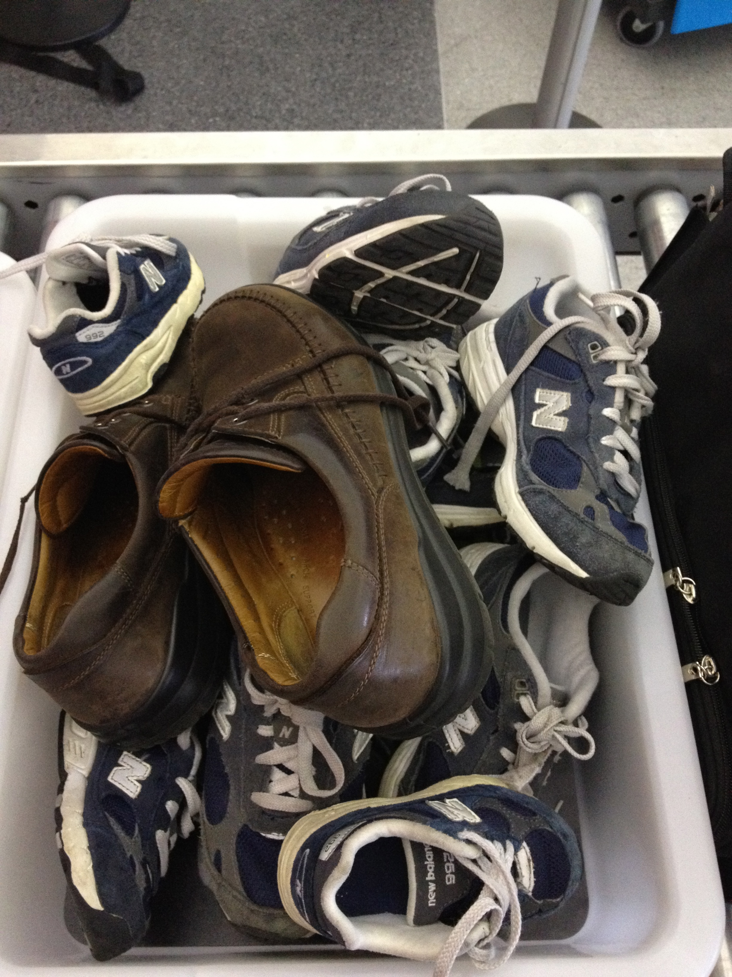Shoes going through airport security.
