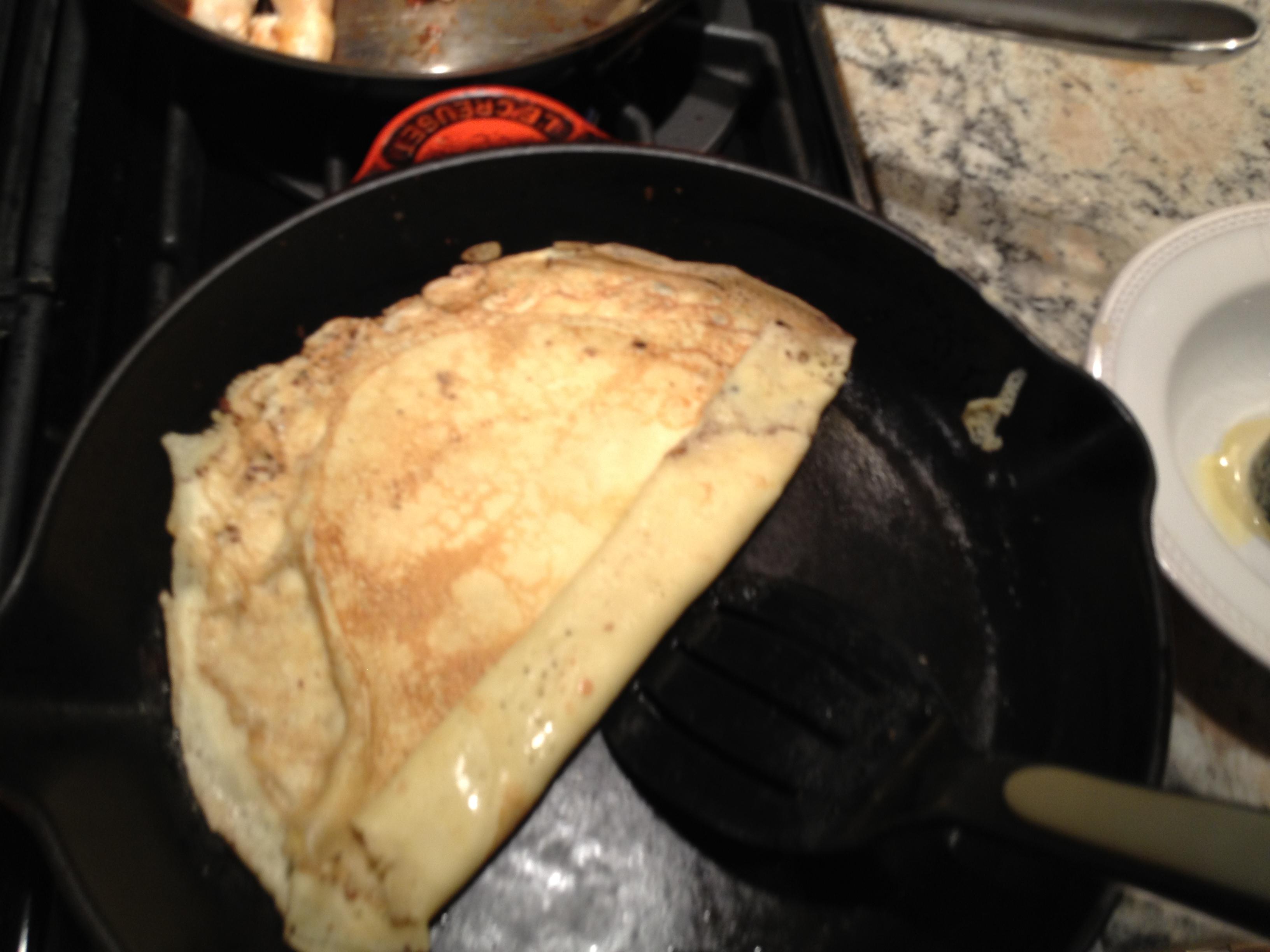 Swedish pancakes rolling in pan