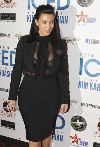 Kim Kardashian bares her pregnant body and bosom.
