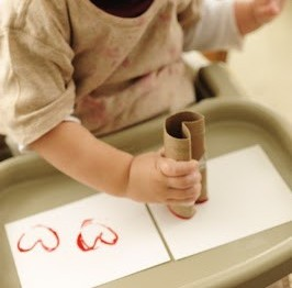 Fun Valentine's Day craft for your toddler using an empty toilet paper roll.