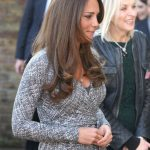 Pregnant Kate Middleton shows off her baby bump.