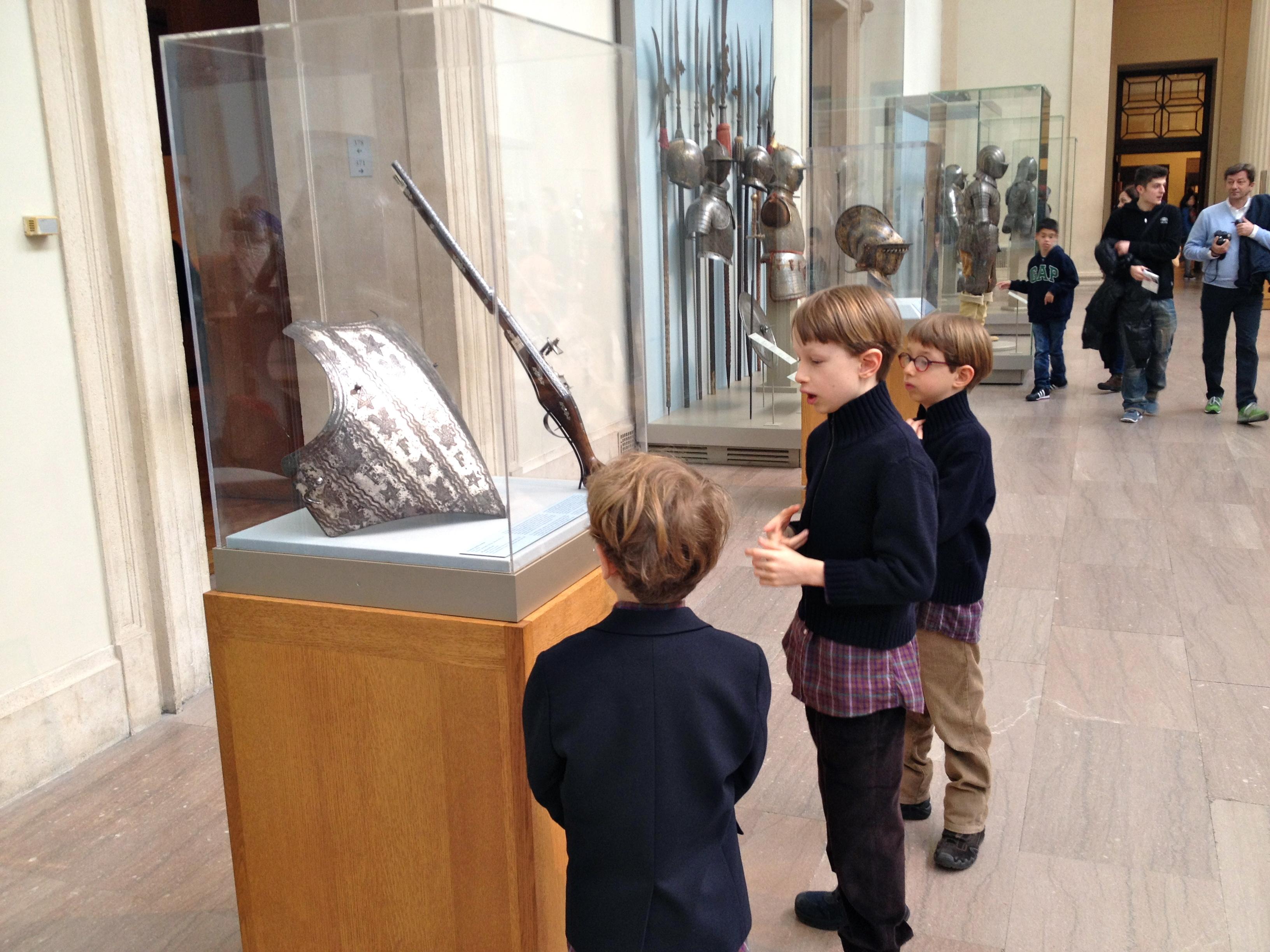 Boys admiring guns