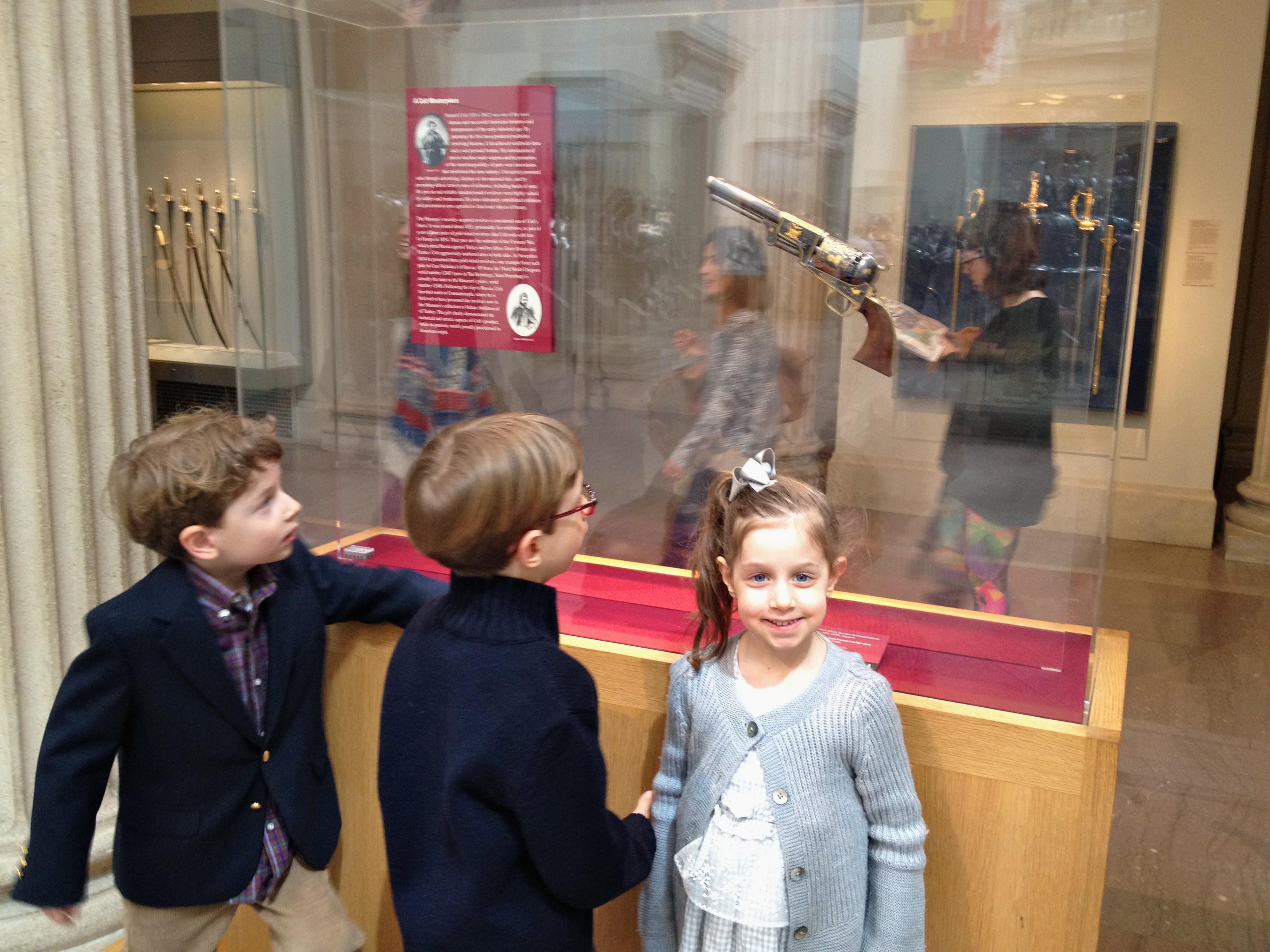 Boys looking at gun