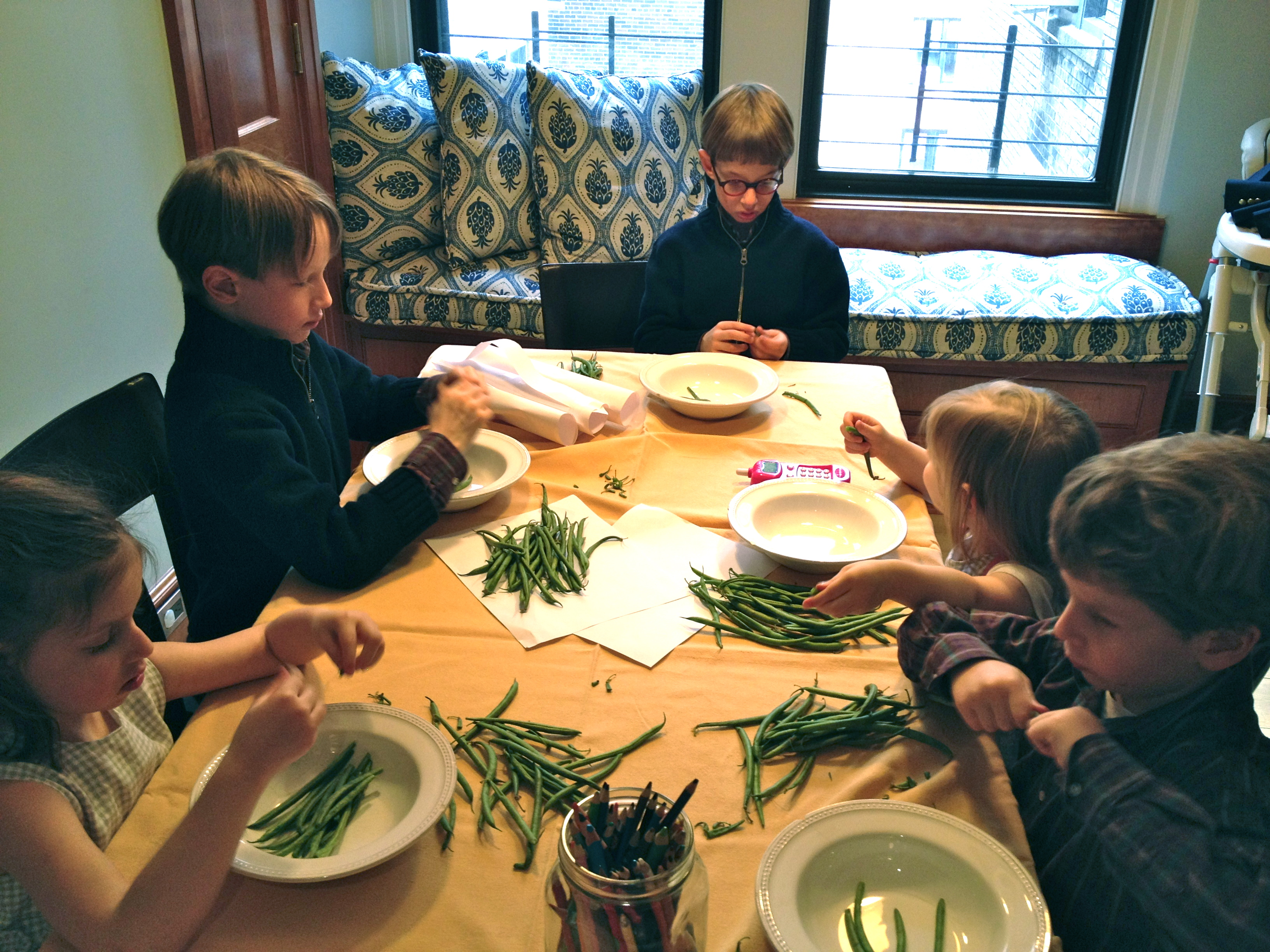 Kids snapping beans
