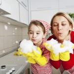 Mom cleaning with child