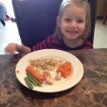 Marielle eating chicken