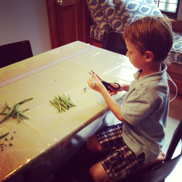 Child cutting beans