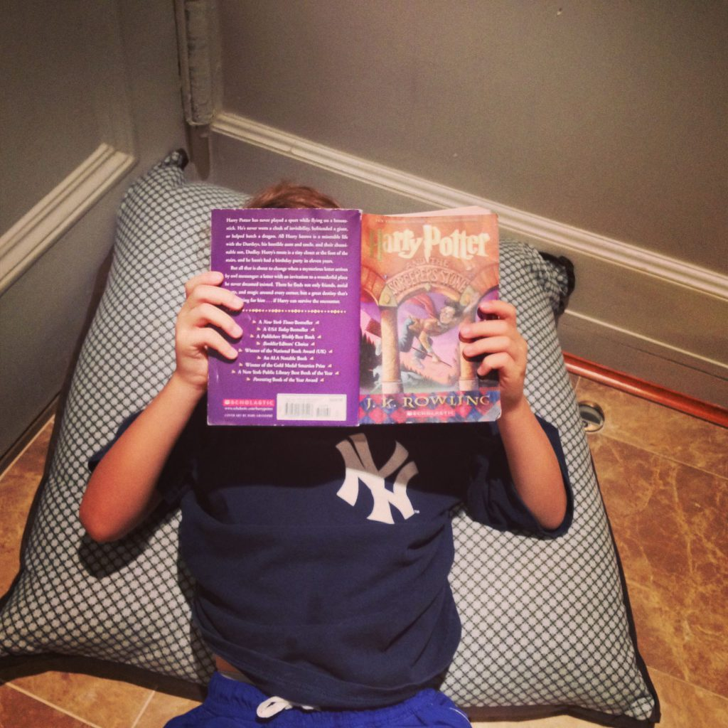 Boy reading Harry Potter