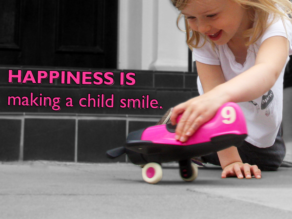 Happiness is making a child smile.