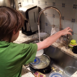 kid doing chores
